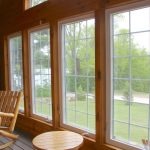 Cabin on the Hill at Fernleigh Lodge has a beautiful Sun room facing the Lake!